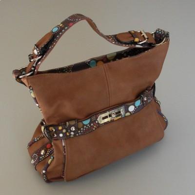 design intemporel 347b4 39ee5 Un sac en simili cuir de couleur marron en bon état