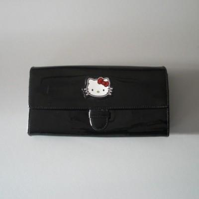 hot-vente plus récent vente au royaume uni large éventail Un porte-monnaie et porte documents de Hello Kitty by Victoria Couture